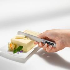 Buttermesser SPREAD THAT!® - Erwärmt sich in Sekunden durch Ihre Körpertemperatur. Streicht mühelos feine Streifen von eiskalter Butter.
