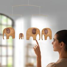 The Elefant Party, Luxusmobile - Dänemarks legendäres Elefanten-Mobile: einst für Kinder – jetzt erwachsen aus Teakholz und Leder.