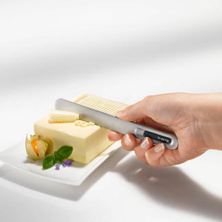 Buttermesser SPREAD THAT!® Erwärmt sich in Sekunden durch Ihre Körpertemperatur. Streicht mühelos feine Streifen von eiskalter Butter.