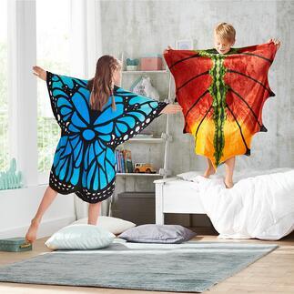 Motiv-Schlupfdecke Nur überstreifen: schon ein verwunschener Schmetterling oder Drache – und kuschelig gewärmt.