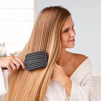 Touch & Glide Fingerbrush Entwirrt das Haar besonders schonend und massiert gleichzeitig sanft die Kopfhaut.