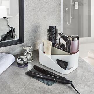 HaartoolOrganizer Ihre wichtigsten Haartools: ordentlich, gesammelt und griffbereit. Der bessere Styling-Organizer mit rutschfester Abkühlmatte und herausnehmbarer Unterteilung.