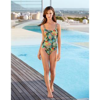 Dieser Badeanzug wirkt wie eine gute Sonnencreme. Aus Sonnen durchlässigem SunSelect® – mit außergewöhnlichem Palmen/Hibiskus-Print.