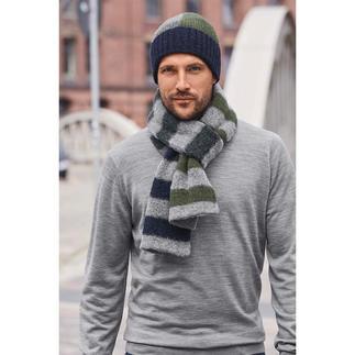 Die Colourblock-Mütze und der Streifen-Schal vom jungen belgischen Label Howlin'. Modische Muster, trendige Farben. Aber traditionell in Schottland gestrickt.
