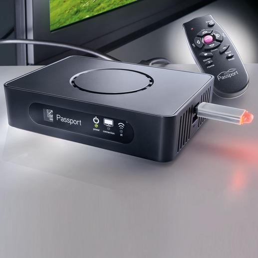 Ist der Mediaplayer per Komponenten- oder HDMI-Kabel (beide mitgeliefert) mit Ihrem TV verbunden, sendet er die Trainingsstrecken per Funk.