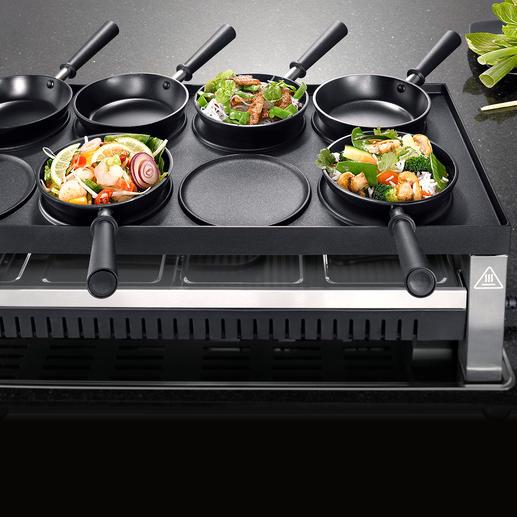 Drehen Sie die riesige 1.350cm² Grillplatte um und bereiten Sie asiatische Spezialitäten in den Mini-Woks...