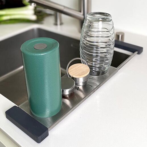 Drip-itSpülbecken-Ablage Der perfekte Spültuch- und Flaschenhalter. Und zugleich multifunktionelle Abtropf- und Abstell-Lösung rund ums Spülbecken.