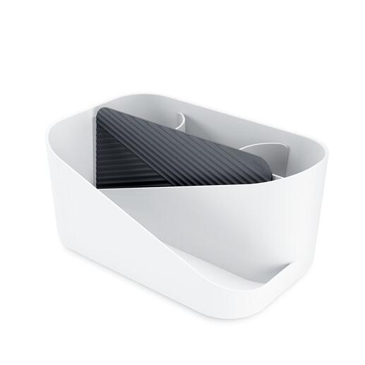 Aus stabilem weißem Kunststoff – und inklusive Silikon-Matte zum Ablegen heißer Stylinggeräte.